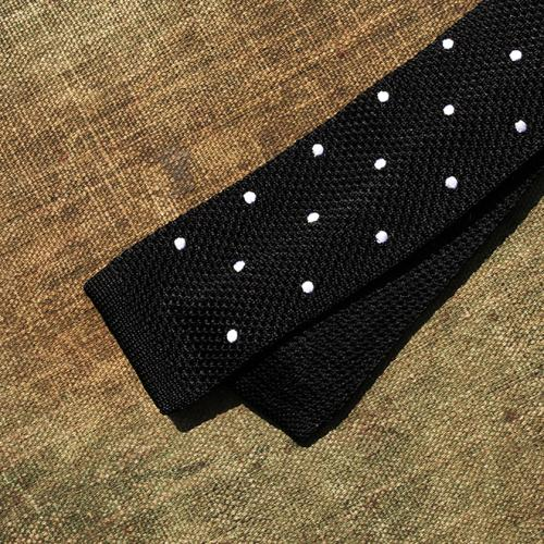 A Black silk scarf with white polkadot tie